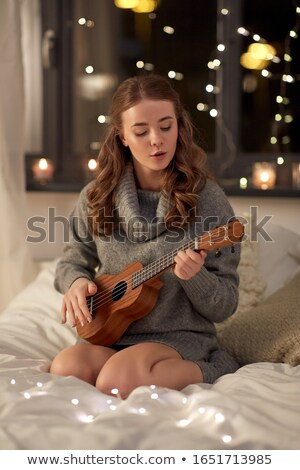 Young woman with a guitar and singing Stock photo © photography33