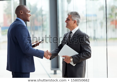 Senior business man shaking hands Stock photo © ivonnewierink