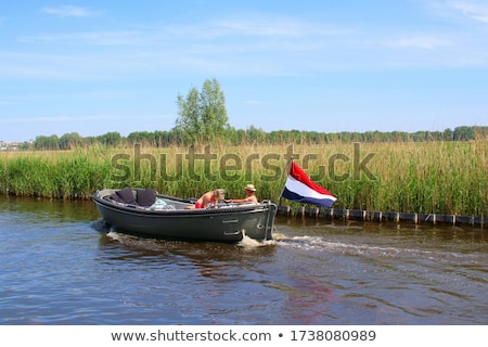 Boat on Dutch river Stock photo © ivonnewierink