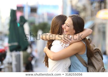 two beautiful female friends hugging stock photo © konradbak