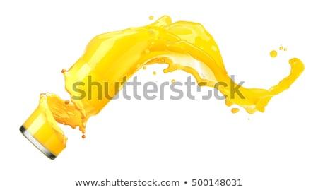 Orange juice against white background with an orange Stock photo © wavebreak_media
