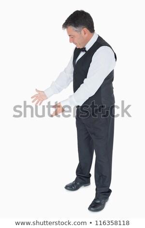 De ober tonen iets beide handen shirt Stockfoto © wavebreak_media