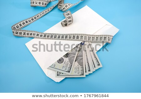 dollars banknote in the envelope isolated on white background stock photo © luckyraccoon