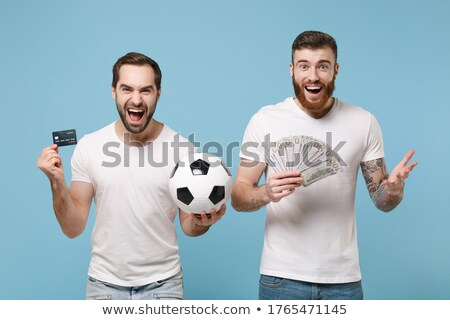Football fans holding a ball Stock photo © photography33