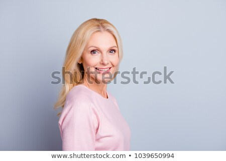 Cute blonde lady with clear complexion Stock photo © konradbak
