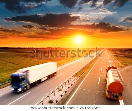 Dois caminhões estrada nascer do sol blue sky Foto stock © marcelozippo