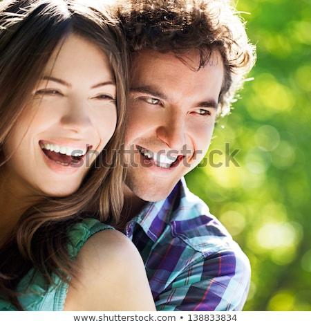 Przypadkowy para uśmiechnięta kobieta za człowiek młodych Zdjęcia stock © feedough