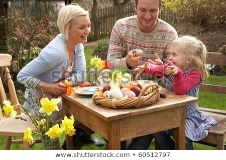 Mother And Children Decorating Easter Eggs On Table Outdoors Stock photo © monkey_business