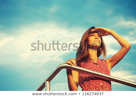 Young and beautiful woman in sunset light looking far away Stock photo © HASLOO