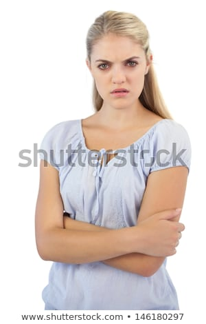Beautiful blond woman frowning at the camera Stock photo © dash