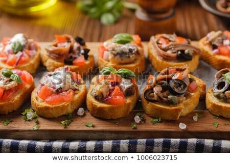 Bruschetta tomaat rustiek presentatie voedsel vis Stockfoto © Photooiasson