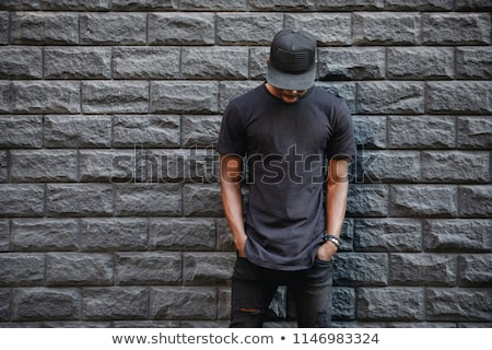 Man in black fashionable T-shirt and cap stock photo © boroda