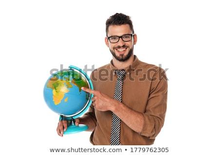 boldog · férfi · mutat · ujj · földgömb · fiatalember - stock fotó © deandrobot