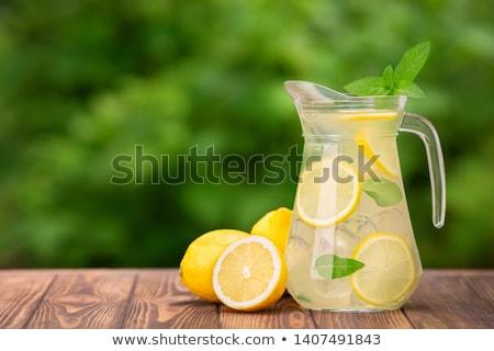 Limonádé kancsó jeges citrom balzsam rusztikus Stock fotó © maxsol7