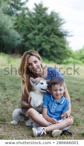 happy mother and son with puppy stock photo © wavebreak_media