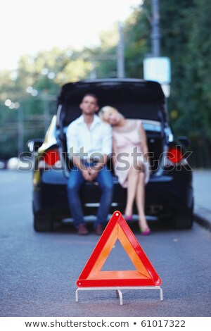woman with a red triangle sign on a road stock photo © nobilior
