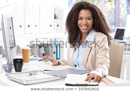 Woman office worker typing on the keyboard Stock photo © vlad_star