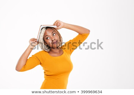 Funny pensive african american woman with book on her head  Stock photo © deandrobot