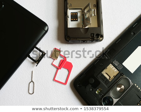 Stock photo: Smartphone and SIM card on office table, top view