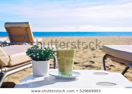 Latte at the beach Stock photo © frimufilms