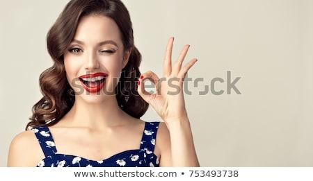 mujer · sonriente · signo · aislado · blanco - foto stock © nobilior