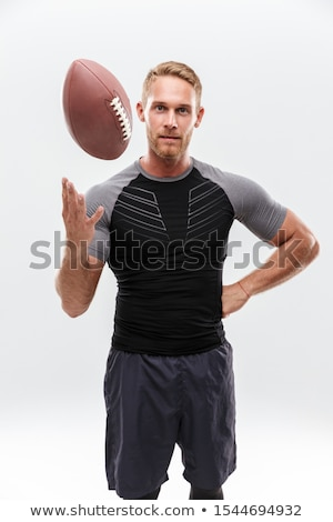 Portrait of confident male player holding rugby ball Stock photo © wavebreak_media