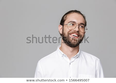 cheerful young man posing isolated over grey background stock photo © deandrobot