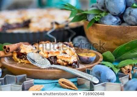 Plum pie with cinamon and almonds Stock photo © Karaidel
