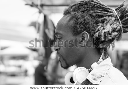 Portrait of thoughtful black man outdoor in a weekly clothhes ma Stock photo © DisobeyArt
