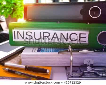 insurance on green office folder toned image stock photo © tashatuvango