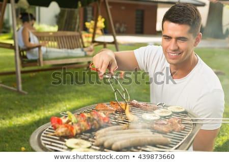 mosolyog · emberek · beszélnek · iszik · sör · asztal · kint - stock fotó © is2