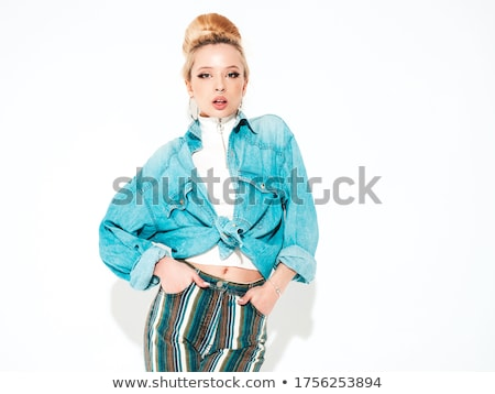 sexy blond woman in jeans jacket stock photo © arturkurjan