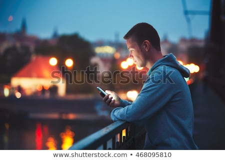 moço · telefone · móvel · quarto · bonito · sorrir · móvel - foto stock © dolgachov