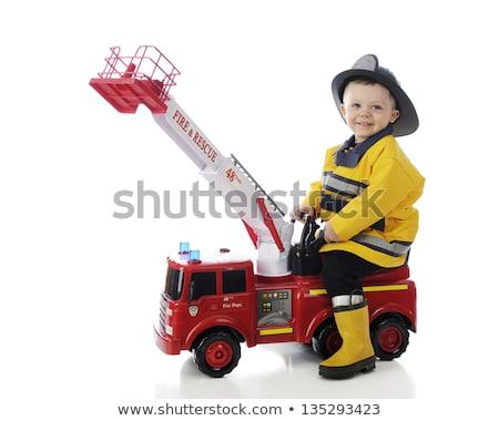 Mały chłopca gry wóz strażacki dziecko zabawki Zdjęcia stock © IS2