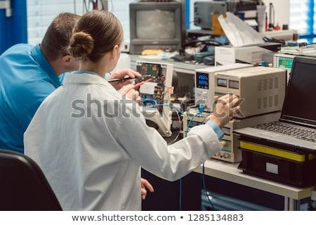 Team of electronic engineers testing a product prototype Stock photo © Kzenon