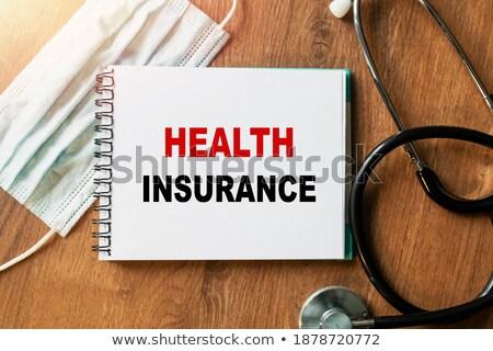 Top woord verzekering stethoscoop tabel Stockfoto © vinnstock