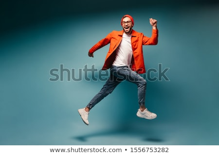 Retrato hombre suéter pie aislado beige Foto stock © deandrobot