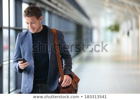 glimlachend · jonge · zakenman · laptop · vergadering · mobiele · telefoon - stockfoto © deandrobot