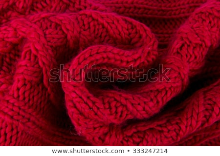 Yellow and red knitted scarf, white woolen threads Stock photo © robuart