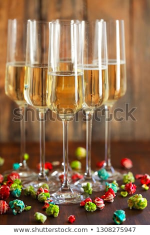 Champagne with pop corn on wooden background  Stock photo © dashapetrenko