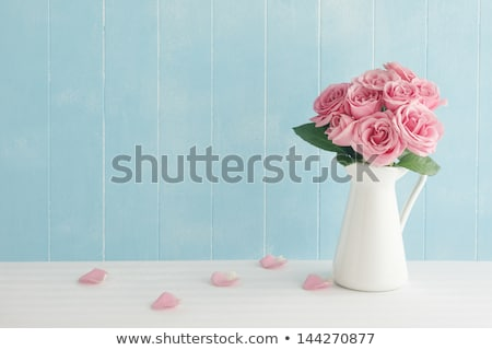 rose bouquet pink flowers with leaves in vase stock photo © robuart