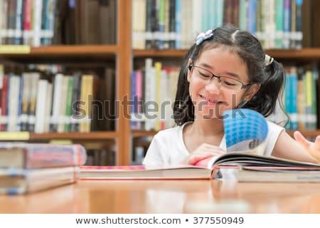 tanár · lány · olvas · könyv · könyvtár · női - stock fotó © artfotodima