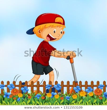 A boy playing kick schooter in garden Stock photo © colematt