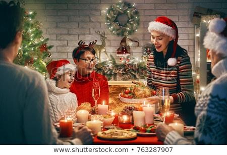 happy family having christmas dinner at home stock photo © dolgachov