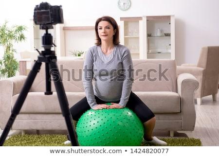 terhes · nő · testmozgás · labda · otthon · ház · boldog - stock fotó © elnur