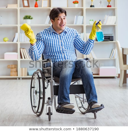 The disabled man cleaning floor at home Stock photo © Elnur