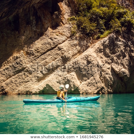 Woman on a kayak in the Pyrenees mountains in Catalonia Stock photo © Kzenon