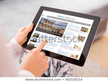 hand with tablet reading news stock photo © ra2studio