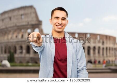 man pointing to you over coliseum background Stock photo © dolgachov
