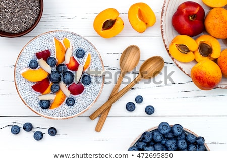 Yogurt in a bowl with chia seeds Stock photo © bdspn